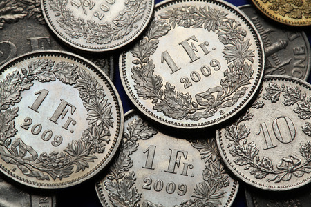 franc: Coins of Switzerland. Swiss one franc coins. Stock Photo