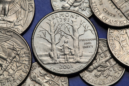 25 cents: Coins of USA. Maple trees with sap buckets and Camels Hump Mountain depicted on the US Vermont quarter (2001).