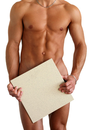 male nude: Nudo uomo muscolare che copre con una piastrella quadrata (copia spazio) isolato su bianco Archivio Fotografico