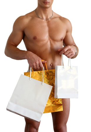 Sexy muscular man covering with shopping bags (copy space) isolated on white Stock Photo