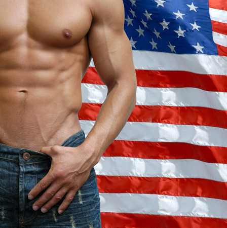 Muscular male torso with US flag behind photo