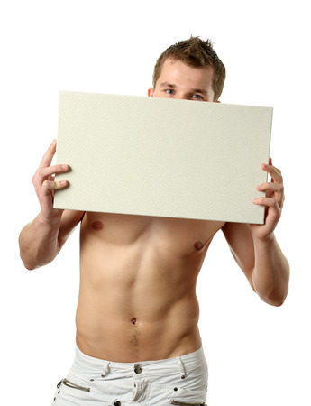 attractive male: Young sexy man with copy space billboard isolated on white Stock Photo