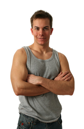 Young muscular man wearing a gray athletic shirt isolated on white photo