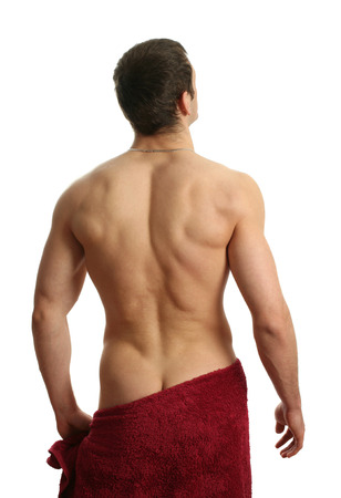 nude back: Young muscular man wrapped in a red towel isolated on white