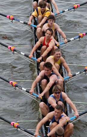 rowing: Junior rowing team rowing ahead during a boat-race on the River Vltava in Prague, Czech Republic.