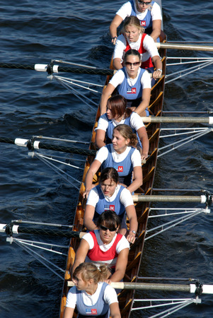 Junior female rowing team rowing ahead during a boat-race on the River Vltava in Prague, Czech Republic