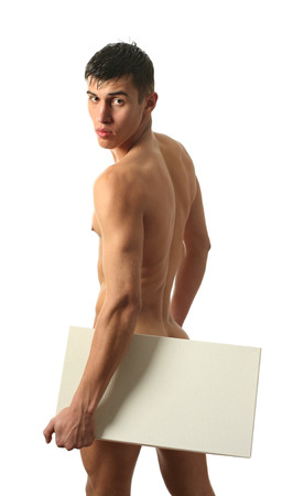 nude sport: Nude muscular man covering with a copy space blank board isolated on white