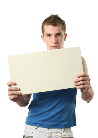 Young sexy man covering a copy space blank billboard isolated on white photo