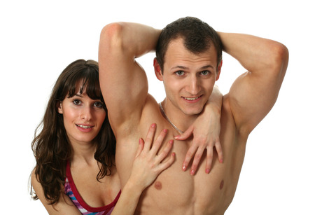 embracement: Young woman embracing her muscular boyfriend with flexing biceps isolated on white