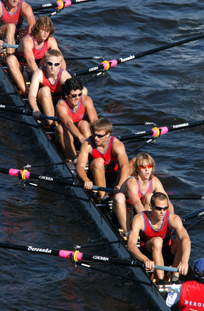 rowing: Junior rowing team rowing ahead during a boat-race on the River Vltava in Prague, Czech Republic