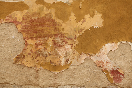 chipped: Old wall with cracked plaster. Background texture.
