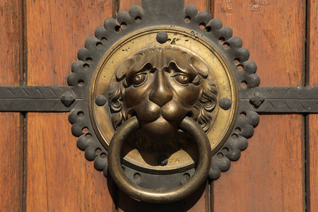 Knocker at a door of St Thomas Church (Thomaskirche) in Leipzig, Saxony, Germany. photo