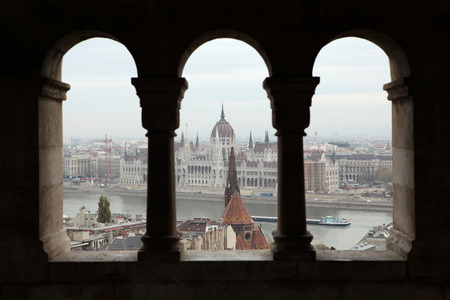 Hungarian Parliament on the embankment of the Danube seen from the neo-Romanesque terrace of the Fishermans Bastion in Budapest, Hungary. photo