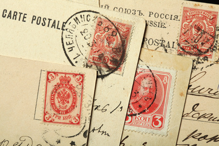 double headed: Tsar Alexander III of Russia and Russian double-headed eagles depicted in the Russian postage stamps on the old postcards.
