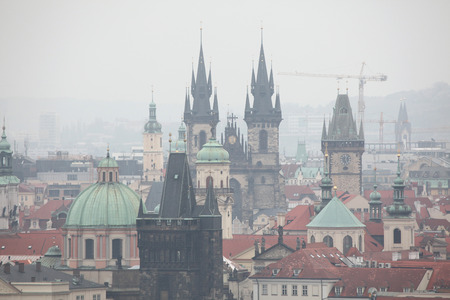 Tyn Church and the Old Town Hall in Old Town Square viewed from Petrin Hill in Prague, Czech Republic. photo