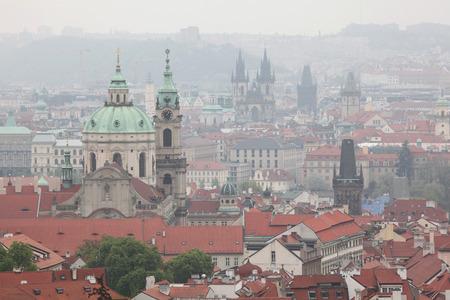 Saint Nicholas Church in Mala Strana and the Tyn Church in Old Town Square viewed from Petrin Hill in Prague, Czech Republic. photo