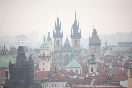 old town square: Tyn Church and the Old Town Hall in Old Town Square viewed from Petrin Hill in Prague, Czech Republic. Stock Photo