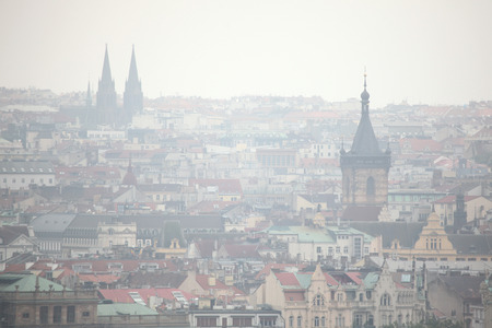 New Town Hall in Charles Square and Saint Ludmila Church viewed from Petrin Hill in Prague, Czech Republic.