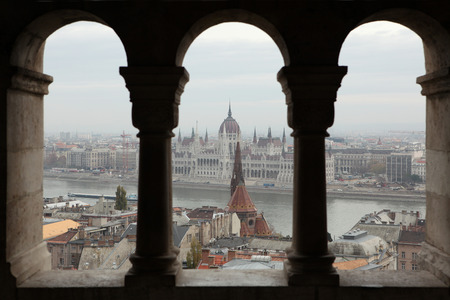 gothic revival style: Hungarian Parliament on the embankment of the Danube seen from the neo-Romanesque terrace of the Fisherman Stock Photo