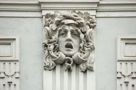 heads old building facade: Medusa Gorgon. Mascaron on the Art Nouveau building in Prague, Czech Republic.