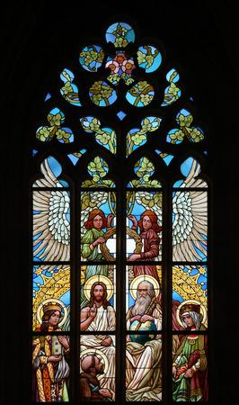 Holy Trinity. Art Nouveau stained glass window in Saint Barbara Church in Kutna Hora, Czech Republic.