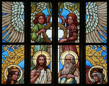 barbara: Holy Trinity. Art Nouveau stained glass window in Saint Barbara Church in Kutna Hora, Czech Republic.