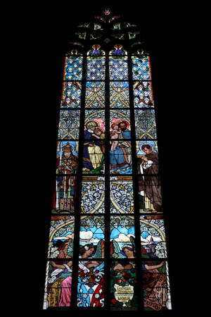 The Holy Family. Art Nouveau stained glass window in Saint Barbara Church in Kutna Hora, Czech Republic.