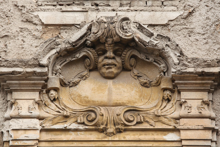 heads old building facade: Funny mascaron on the Art Nouveau building in Prague, Czech Republic.