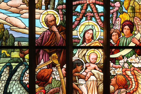 family church: The Holy Family. Art Nouveau stained glass window in Saint Barbara Church in Kutna Hora, Czech Republic. Editorial