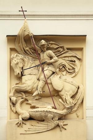 Saint George killing the Dragon. Stucco decoration on the Art Nouveau building in Prague, Czech Republic. photo