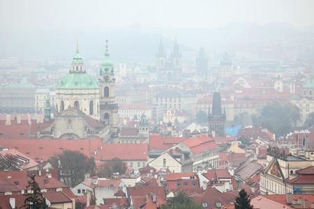 Saint Nicholas Church in Mala Strana and the Tyn Church in Old Town Square viewed from Petrin Hill in Prague, Czech Republic. Reklamní fotografie