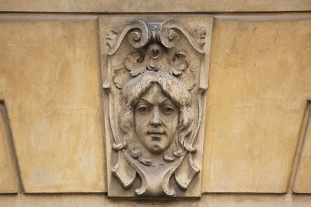 heads old building facade: Mascaron on the Art Nouveau building in Prague, Czech Republic.