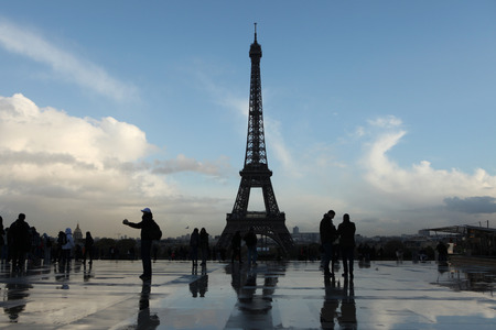 trocadero: PARIS, FRANCE - NOVEMBER 14, 2013: People walk in front of the Eiffel Tower on the Champ de Mars in Paris, France. Editorial