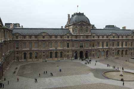 sully: PARIS, FRANCE - JANUARY 5, 2013: People walk in front of the Renaissance wing of the Louvre Museum in Paris, France.