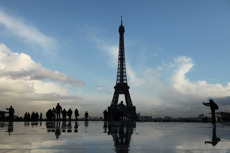 champ: PARIS, FRANCE - NOVEMBER 14, 2013: People walk in front of the Eiffel Tower on the Champ de Mars in Paris, France. Editorial