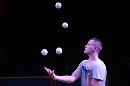 DRESDEN, GERMANY - MARCH 30, 2014: Talented juggler Alexander Koblikov (Ukraine) performs with Russian Grand Circus in Dresden, Germany, on March 30, 2014.