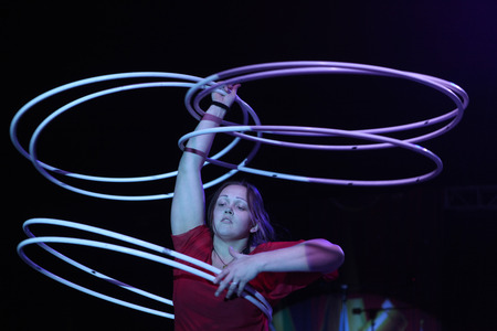 alexandra: DRESDEN, GERMANY - MARCH 31, 2014: Hula hoop juggler Alexandra Soboleva (Ukraine) performs with Russian Grand Circus in Dresden, Germany, on March 31, 2014.