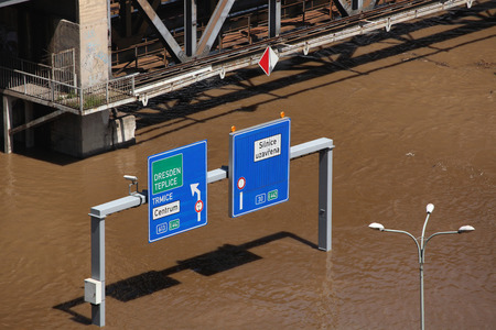 flood area sign: USTI NAD LABEM, CZECH REPUBLIC - JUNE 5, 2013: Traffic signs on a highway flooded by the swollen Elbe River in Usti nad Labem, Northern Bohemia, Czech Republic, on June 5, 2013. Editorial