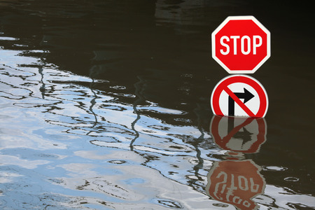 flood area sign: USTI NAD LABEM, CZECH REPUBLIC - JUNE 5, 2013: Stop and No right turn, traffic signs flooded by the swollen Elbe River in Usti nad Labem, Northern Bohemia, Czech Republic, on June 5, 2013.