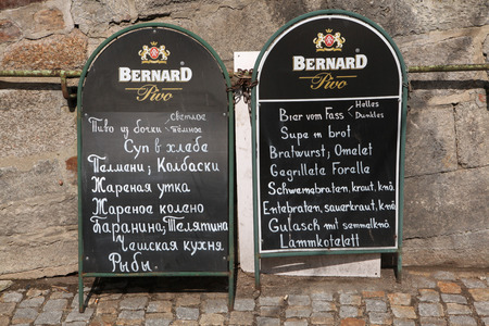 karlovy: KARLOVY VARY, CZECH REPUBLIC - MAY 8, 2013: Restaurant outdoor menu in German and Russian languages in Karlovy Vary, Czech Republic.