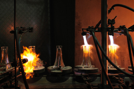 glasswork: SVETLA NAD SAZAVOU, CZECH REPUBLIC - NOVEMBER 7, 2014: Automatic production of decorative glass vases at the Bohemian glass factory Crystalite Bohemia in Svetla nad Sazavou, Czech Republic.