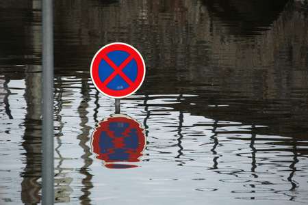 flood area sign: USTI NAD LABEM, CZECH REPUBLIC - JUNE 5, 2013: No stopping, a traffic sign flooded by the swollen Elbe River in Usti nad Labem, Northern Bohemia, Czech Republic, on June 5, 2013. Editorial