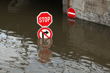 nad: USTI NAD LABEM, CZECH REPUBLIC - JUNE 5, 2013: Stop and No right turn, traffic signs flooded by the swollen Elbe River in Usti nad Labem, Northern Bohemia, Czech Republic, on June 5, 2013.