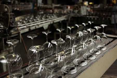 stemware: SVETLA NAD SAZAVOU, CZECH REPUBLIC - NOVEMBER 7, 2014: Automatic production of machine blown stemware at the Bohemian glass factory Crystalite Bohemia in Svetla nad Sazavou, Czech Republic.