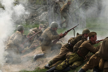 ORECHOV, CZECH REPUBLIC - APRIL 27, 2013: Re-enactors dressed as Soviet soldiers stage an attack during the re-enactment of the Battle at Orechov (1945) near Brno, Czech Republic. The Battle at Orechov in April 1945 was the biggest tank battle in the last Editorial