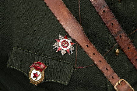 war decoration: ORECHOV, CZECH REPUBLIC - APRIL 27, 2013: Soviet military decoration the Order of the Patriotic War (R) and Soviet Guards badge (L) seen during the re-enactment of the Battle at Orechov (1945) near Brno, Czech Republic. The Battle at Orechov in April 1945