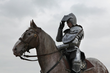 cavalry: MILOVICE, CZECH REPUBLIC - OCTOBER 23, 2013: Actor dressed as a medieval knight rides a horse during the filming of the new movie The Knights directed by Carsten Gutschmidt near Milovice, Czech Republic.