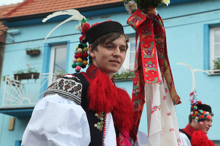 recruit: VLCNOV, CZECH REPUBLIC - MAY 26, 2013: Young men dressed in traditional Moravian folk costume perform the Recruit during the Ride of the Kings folklore festival in Vlcnov, South Moravia, Czech Republic.