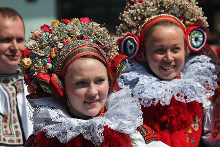 czech women: VLCNOV, CZECH REPUBLIC - MAY 26, 2013: Young women dressed in traditional Moravian folk costumes attend the Ride of the Kings folklore festival in Vlcnov, South Moravia, Czech Republic.