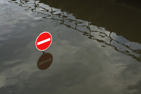 flood area sign: USTI NAD LABEM, CZECH REPUBLIC - JUNE 5, 2013: No entry for vehicles, a traffic sign flooded by the swollen Elbe River in Usti nad Labem, Northern Bohemia, Czech Republic, on June 5, 2013.